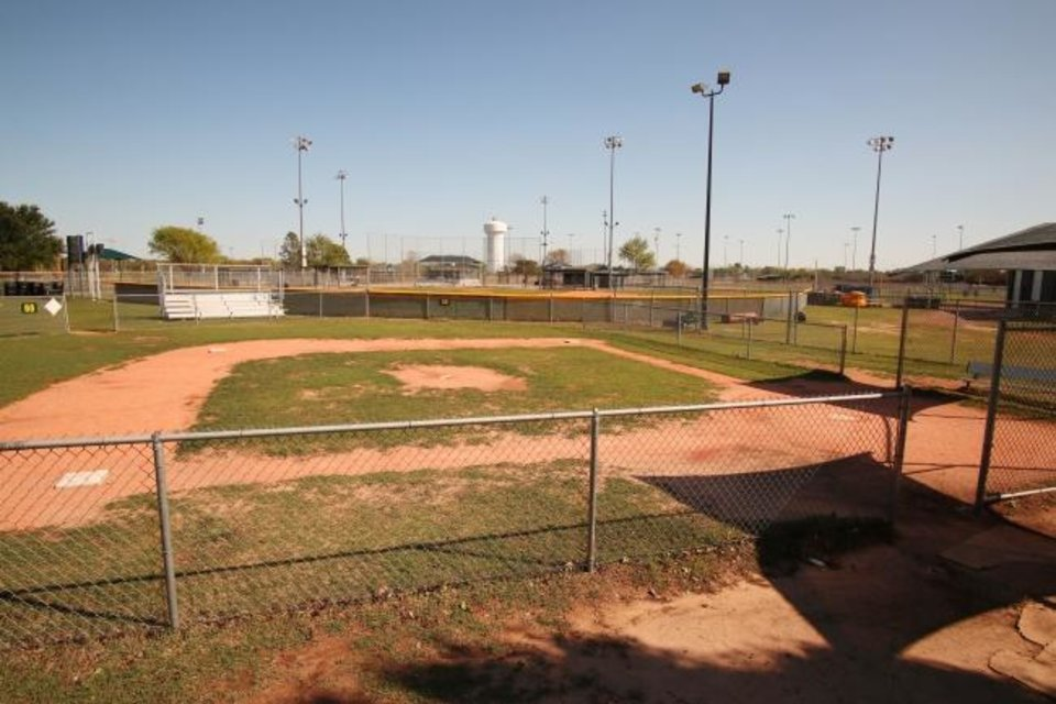 Photo -  Coronavirus in Oklahoma. Because of the Covid-19 Stay-at-Home orders, the ball fields at Buck Thomas Park, in Moore, are deserted when they would have been full of kids playing baseball and softball, Wednesday, April 15, 2020.  [Photo by Doug Hoke/The Oklahoman]