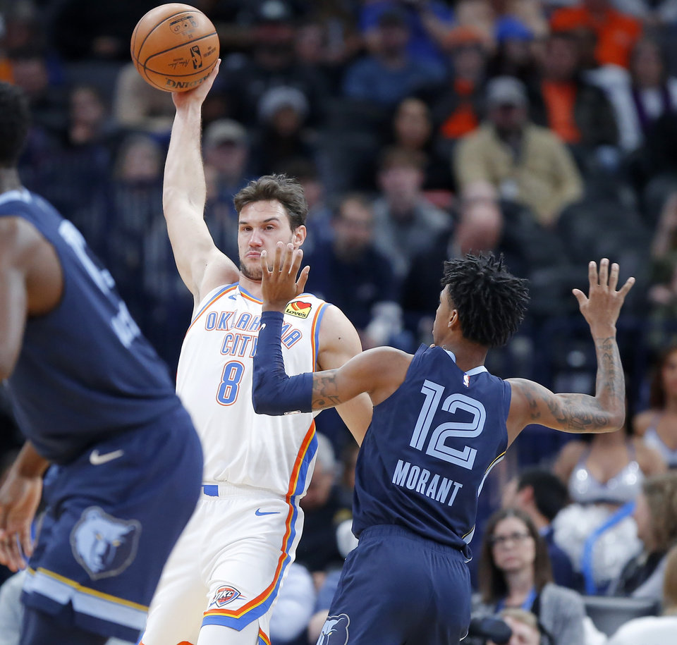 Photo - Oklahoma City's Danilo Gallinari (8) reaches for the ball beside Memphis' Ja Morant (12) during an NBA basketball game between the Oklahoma City Thunder and the Memphis Grizzlies at Chesapeake Energy Arena in Oklahoma City, Wednesday, Dec. 18, 2019. [Bryan Terry/The Oklahoman]
