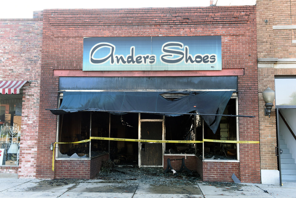 Photo -  Ander's Shoes destroyed by a suspicious fire early Tuesday morning. [Photo by GARY CROW, For the Oklahoman]