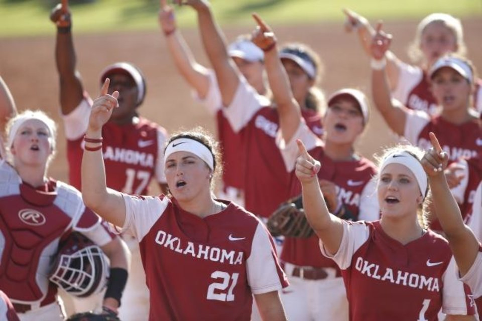Photo -  Oklahoma celebrates following its 2-0 regional-clinching win against Wisconsin on Sunday in Norman. [Sarah Phipps/The Oklahoman]