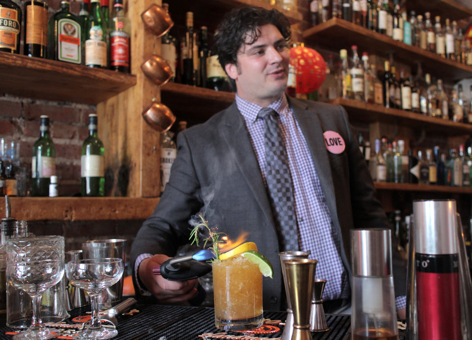 Photo -  Ludivine bartender Colby Poulin makes a Sgt. Pepper's-inspired cocktail based on the song