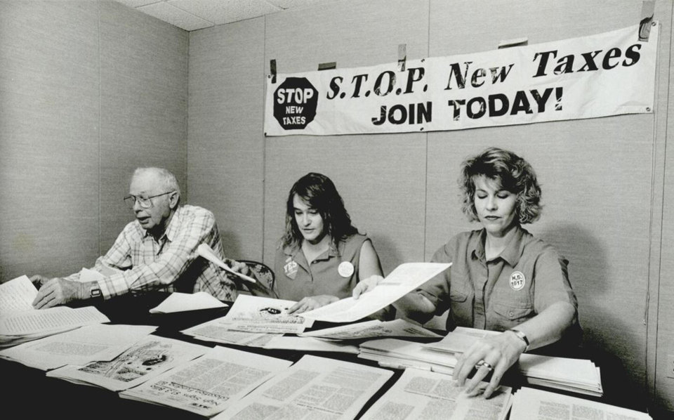 Photo - Working out of their Norman headquarters, STOP New Taxes' volunteers, from left, Dan Goad, Pam Kennedy and Karen Masterson, prepared campaign literature for the Oct. 15, 1991, vote on HB 1017. [Photo by Paul B. Southerland, The Oklahoman Archives]