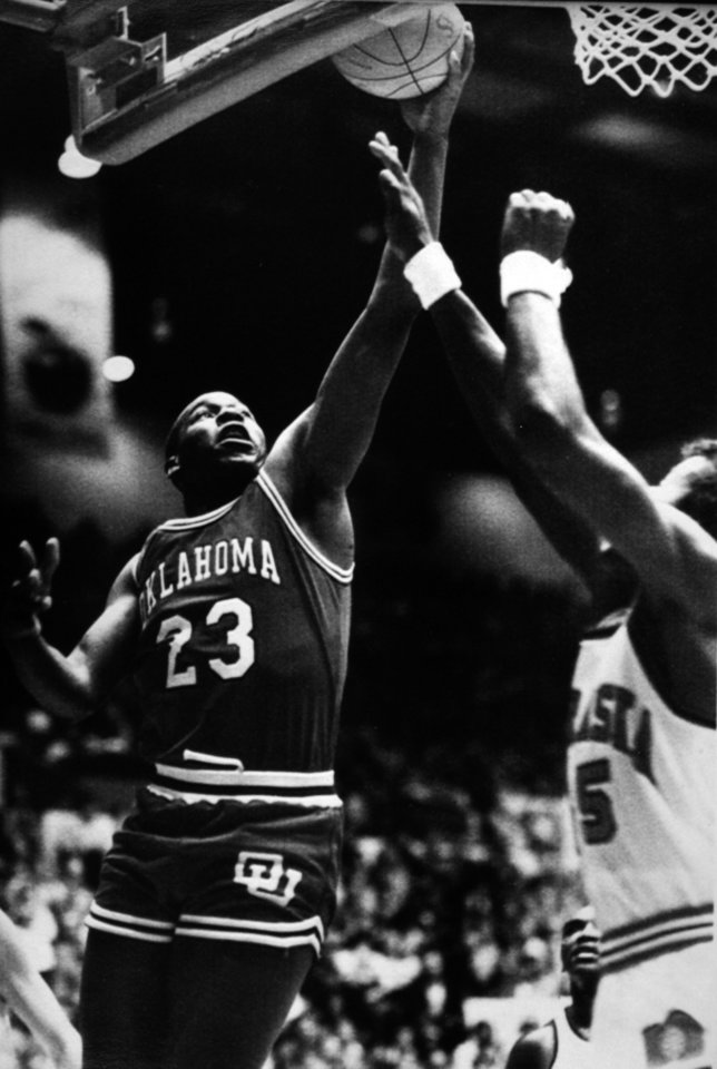 Photo - Former OU basketball player Wayman Tisdale. OU's Wayman Tisdale (33 points) goes for a layup against Nebraska's Stan Cloudy during the Sooners' 78-67 win over the Cornhuskers on Wednesday. Photo taken unknown, Photo published 2/9/1984 in The Daily Oklahoman. ORG XMIT: KOD