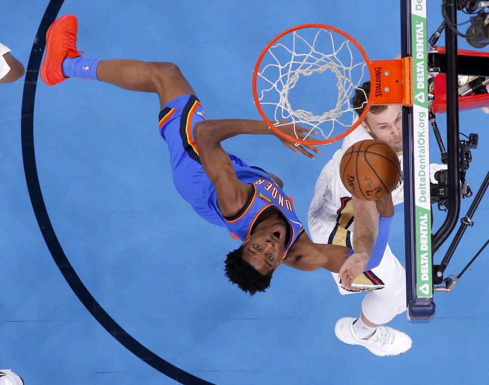 Photo - Oklahoma City's Shai Gilgeous-Alexander (2) makes a basket as New Orleans' Nicolo Melli (20) defends during an NBA basketball game between the Oklahoma City Thunder and the New Orleans Pelicans at Chesapeake Energy Arena in Oklahoma City, Saturday, Nov. 2, 2019. Oklahoma City won 115-104. [Bryan Terry/The Oklahoman]
