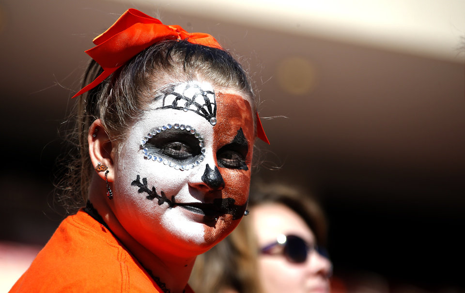 Photo - An OSU fan watches warm ups during the college football game between the Oklahoma State University Cowboys and the TCU Horned Frogs at Boone Pickens Stadium in Stillwater, Okla.,  Saturday, Nov. 2, 2019. [Sarah Phipps/The Oklahoman]