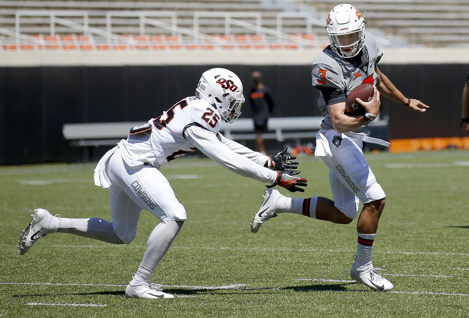 Photo - Oklahoma State's Spencer Sanders (3) gets by Jason Taylor II (25) during a 2-minute drill during the Oklahoma State Cowboys spring practice at Boone Pickens Stadium in Stillwater, Okla., Saturday, April 20, 2019.  Photo by Sarah Phipps, The Oklahoman