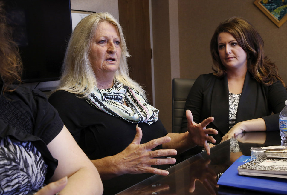 Photo -  Michael Tate Reed II's sister, Mindy Poor, right, and mother , Crystal Tucker, during an interview in the office of the Mental Health Association Oklahoma in Tulsa on Wednesday, Oct. 29, 2014. Reed has suffered from serious mental illness for at least two years, his family says. Reed hasn't ever been formally diagnosed, but mental health experts have told the family that Reed likely has schizoaffective disorder, a brain disease that is a mix of schizophrenia and bipolar disorder. Reed is at a mental health facility, and his family and friends hope he doesn't have to spend time in prison when they say he's suffering from a mental illness and is not a terrorist or Satanist, as some have called him after he admitted to law officers that he drove his vehicle onto the lawn of the state Capitol and crashed into the Ten Commandments monument, toppling it from its base and breaking it into several pieces. Photo by Jim Beckel, The Oklahoman   Jim Beckel -  THE OKLAHOMAN