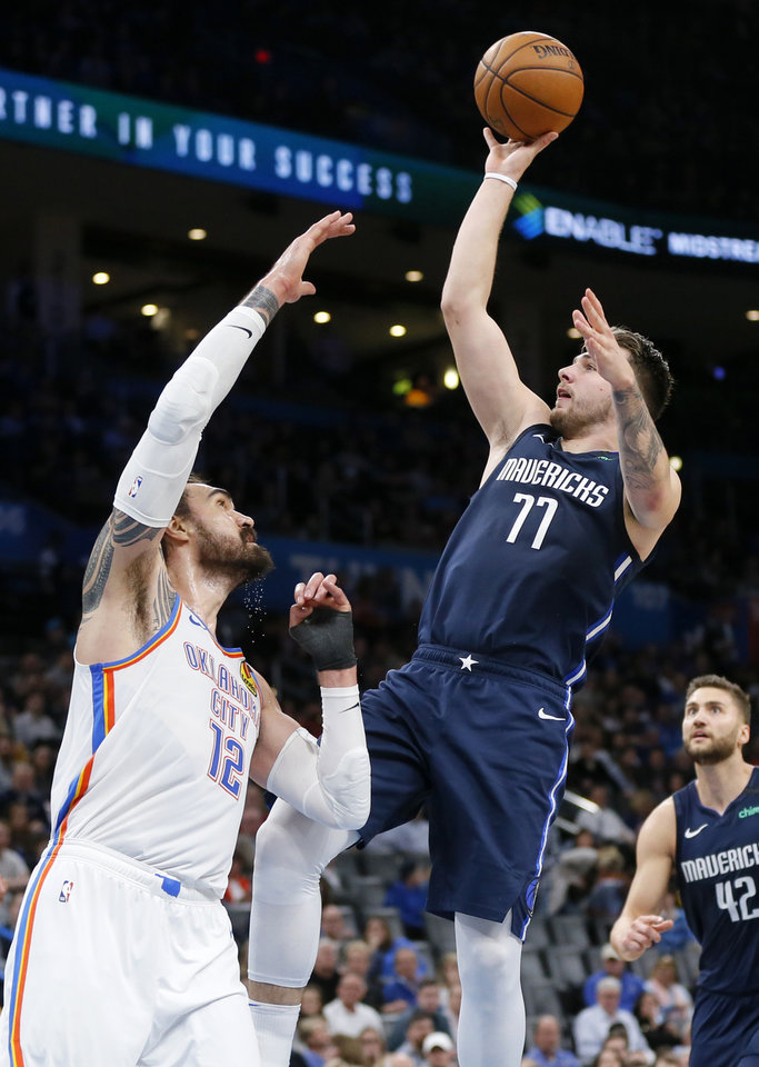 Photo - Dallas' Luka Doncic (77) shoots over Oklahoma City's Steven Adams (12) in the fourth quarter during an NBA basketball game between the Oklahoma City Thunder and Dallas Mavericks at Chesapeake Energy Arena in Oklahoma City, Monday, Jan. 27, 2020. Dallas won 107-97. [Nate Billings/The Oklahoman]