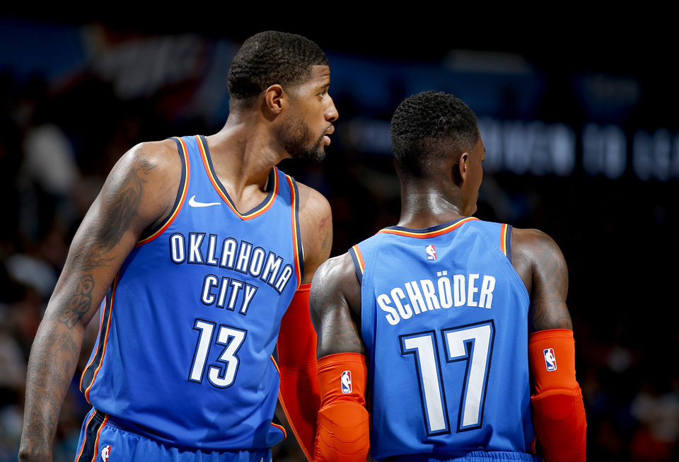 Photo - Oklahoma City's Paul George (13) talks with Oklahoma City's Dennis Schroder (17) during the NBA game between the Oklahoma City Thunder and the Utah Jazz at the Chesapeake Energy Arena, Friday, Feb. 22, 2019. Photo by Sarah Phipps, The Oklahoman