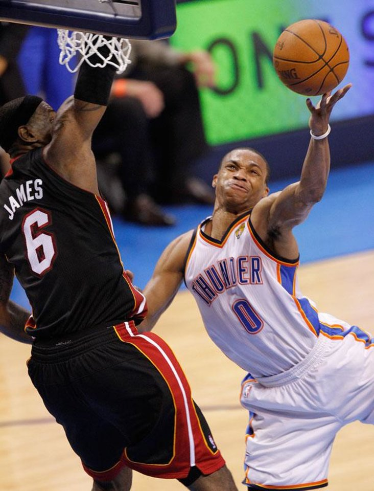 Photo -  Oklahoma City's Russell Westbrook (0) shoots past Miami's LeBron James (6) during Game 2 of the NBA Finals between the Oklahoma City Thunder and the Miami Heat at Chesapeake Energy Arena in Oklahoma City, Thursday, June 14, 2012. Photo by Chris Landsberger, The Oklahoman