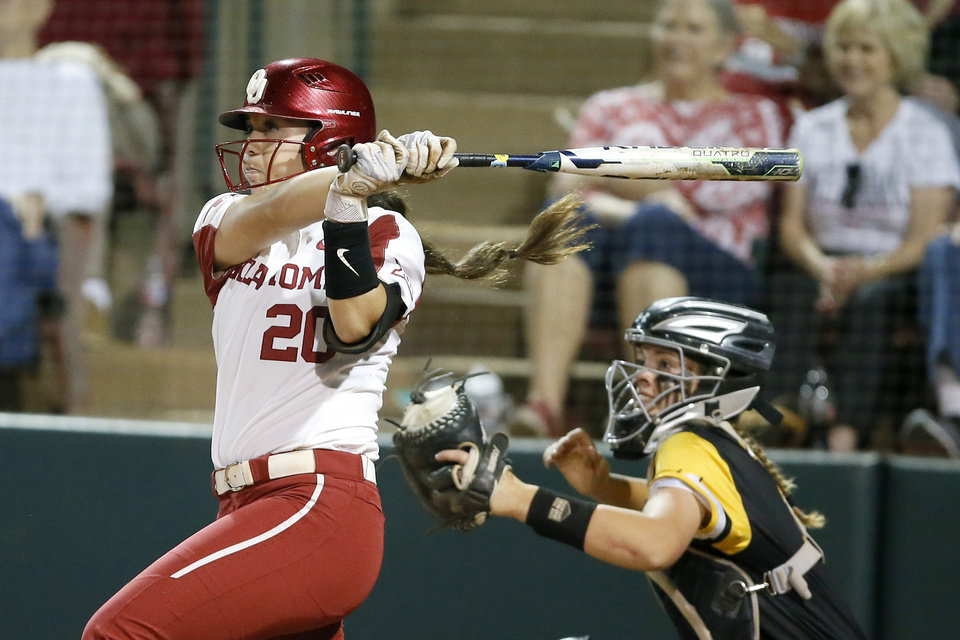 Photo - Oklahoma's Caleigh Clifton (20) hits a two-run home run in the third inning during the Norman Regional NCAA softball tournament game between the University of Oklahoma (OU) and UMBC in Norman, Okla., Friday, May 17, 2019. Oklahoma won 12-0.  [Bryan Terry/The Oklahoman]