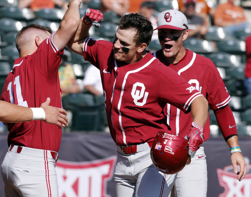 Oklahoma outfielder Blake Brewster is greeted at home after his home run as the  University of Oklahoma Sooners (OU) play the University of Texas Longhorns  ... 20f8da171