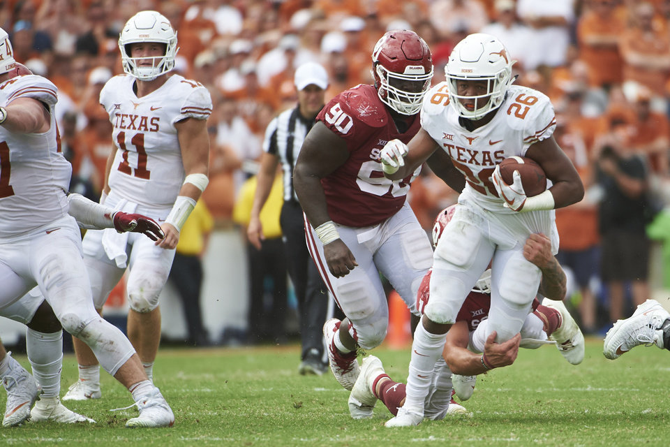 Photo - Texas running back Keaontay Ingram (26) breaks free against Oklahoma during the second half of an NCAA college football game at the Cotton Bowl, Saturday, Oct. 6, 2018, in Dallas. (AP Photo/Cooper Neill)