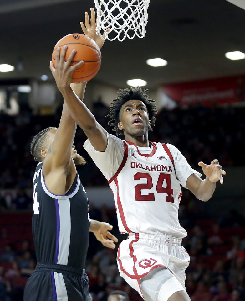 Photo - Oklahoma's Jamal Bieniemy (24) goes to the basket beside Kansas State's Levi Stockard III (34) during an NCAA college basketball game between the University of Oklahoma Sooners (OU) and the Kansas State Wildcats at Lloyd Noble Center in Norman, Okla., Saturday, Jan. 4, 2020. Oklahoma won 66-61. [Bryan Terry/The Oklahoman]