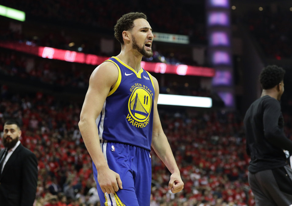 Photo - Golden State Warriors guard Klay Thompson celebrates the team's win over the Houston Rockets in Game 6 of a second-round NBA basketball playoff series Friday, May 10, 2019, in Houston. Golden State won 118-113, winning the series. (AP Photo/Eric Gay)