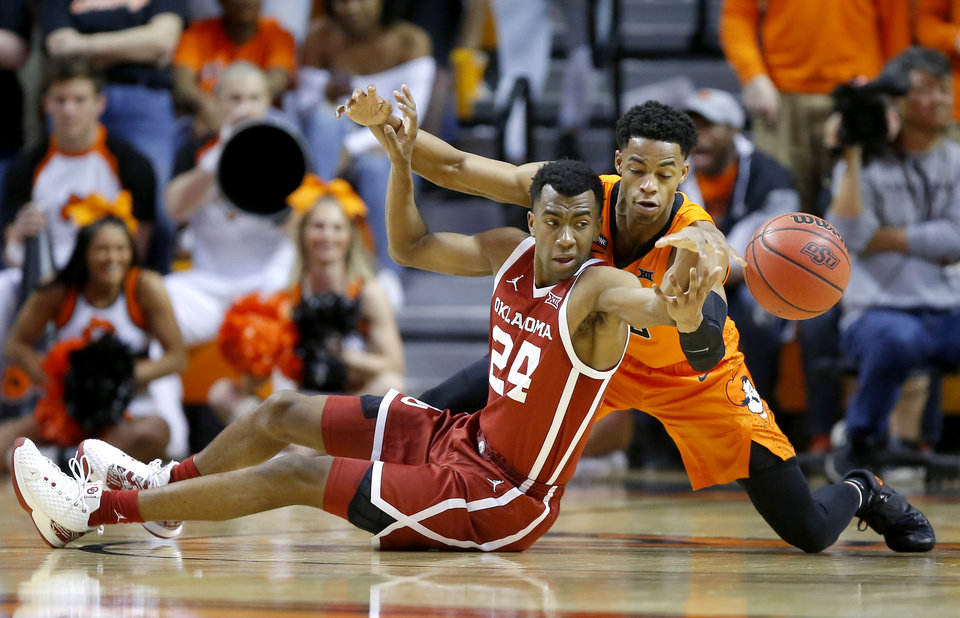 Photo - Oklahoma's Jamal Bieniemy (24) and Oklahoma State's Avery Anderson III (0)  go for the ball during an NCAA men's Bedlam basketball game between the Oklahoma State University Cowboys (OSU) and the University of Oklahoma Sooners (OU) at Gallagher-Iba Arena in Stillwater, Okla., Saturday, Feb. 22, 2020. [Bryan Terry/The Oklahoman]