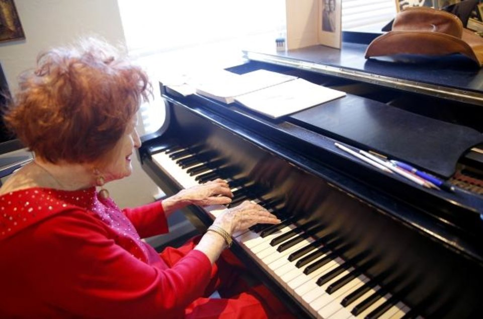 Photo -  Virginia Campbell plays piano Feb. 7 at her home in Oklahoma City. [Sarah Phipps/The Oklahoman Archives]