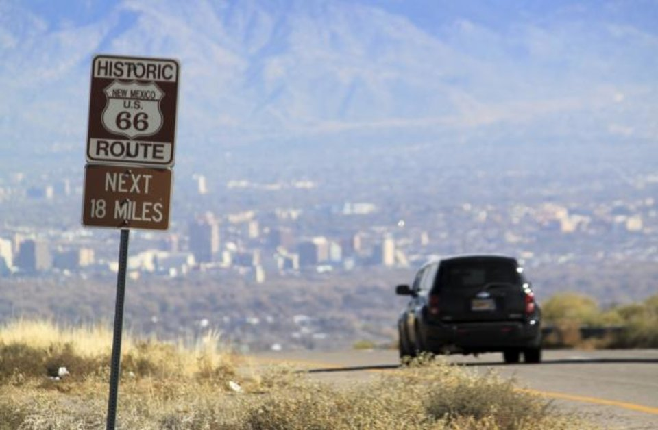 Photo -  A car travels down historic Route 66 toward Albuquerque, N.M., in 2014. Congress has recessed for the 2019 holidays, and it has gone another year without passing legislation that would boost funding for Route 66. [AP FILE PHOTO]