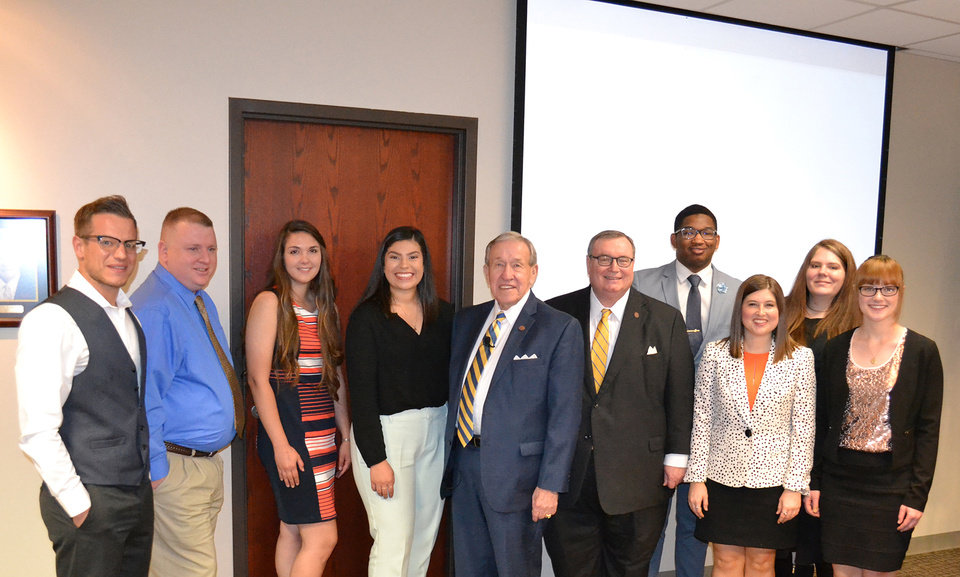 Photo - State higher education officials pose with Newman Civic Fellows.