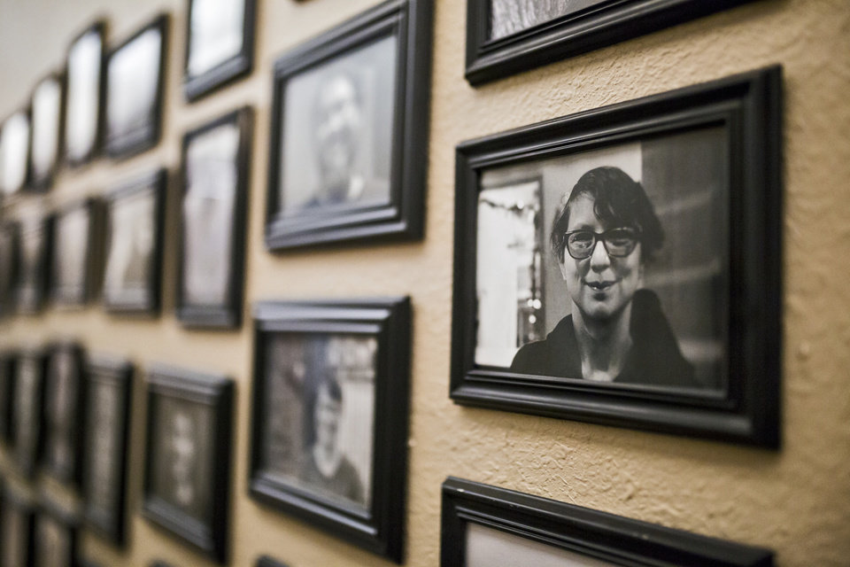 Photo -  Photos of facility members line the walls at the Thunderbird Clubhouse in Norman on Wednesday. The facility offers a community to help those in recovery from mental illness to rediscover their skills and regain their life with family, friends, work and housing. [Photo by Chris Landsberger, The Oklahoman]