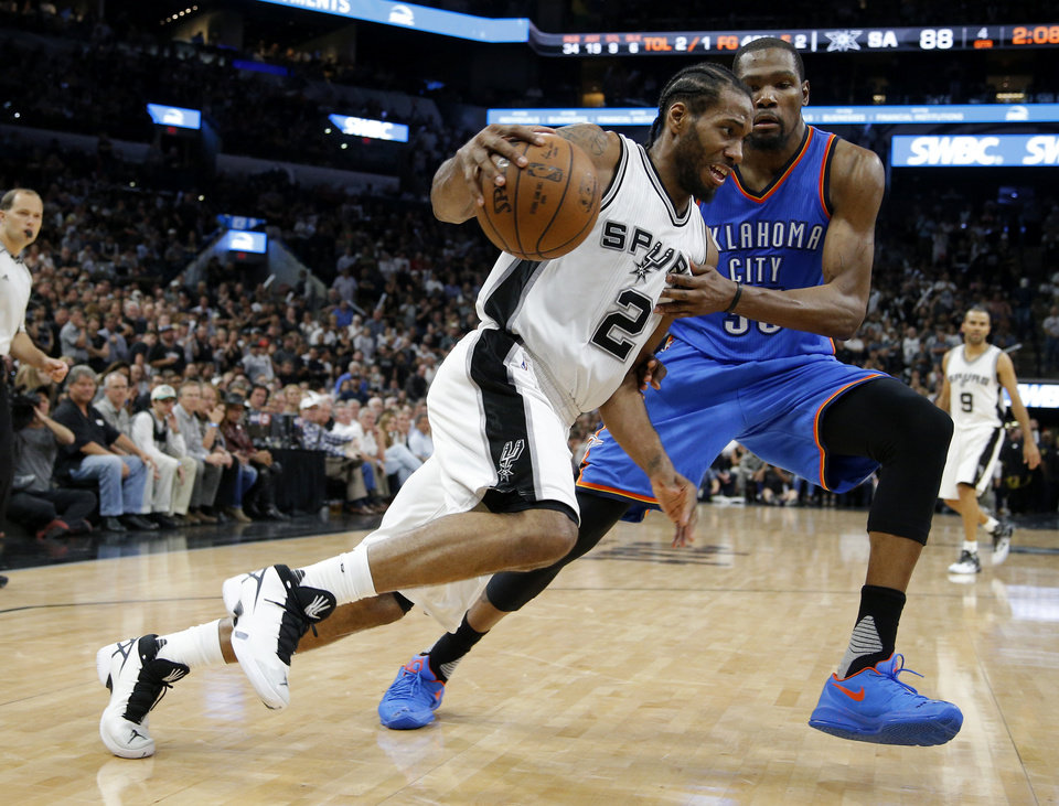 Photo - Oklahoma City's Kevin Durant (35) defends San Antonio's Kawhi Leonard (2) during Game 5 of the second-round series between the Oklahoma City Thunder and the San Antonio Spurs in the NBA playoffs at the AT&T Center in San Antonio, Tuesday, May 10, 2016. Oklahoma City won 95-91. Photo by Bryan Terry, The Oklahoman