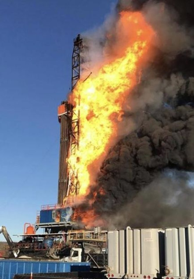 Photo -  A Patterson-UTI drilling rig burns at the well location near Quinton in eastern Oklahoma on Jan. 22. Five men were killed in the explosion and fire. [Photo provided by the U.S. Chemical Safety and Hazard Investigation Board]