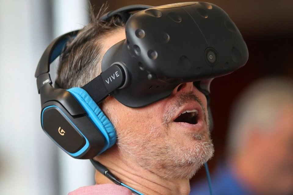 Photo - Tim Fall tries out virtual reality during deadCenter's techCenter at the 21c Museum Hotel, Friday, June 8, 2018. [Photo by Doug Hoke,The Oklahoman Archives]