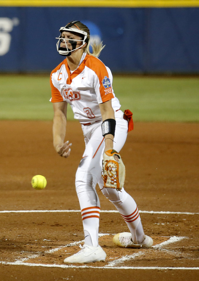 Photo - Oklahoma State's Samantha Show (3) throws a pitch in the first inning during a Women's College World Series between Oklahoma State (OSU) and Oklahoma at USA Softball Hall of Fame Stadium in Oklahoma City,  Friday, May 31, 2019.  [Sarah Phipps/The Oklahoman]