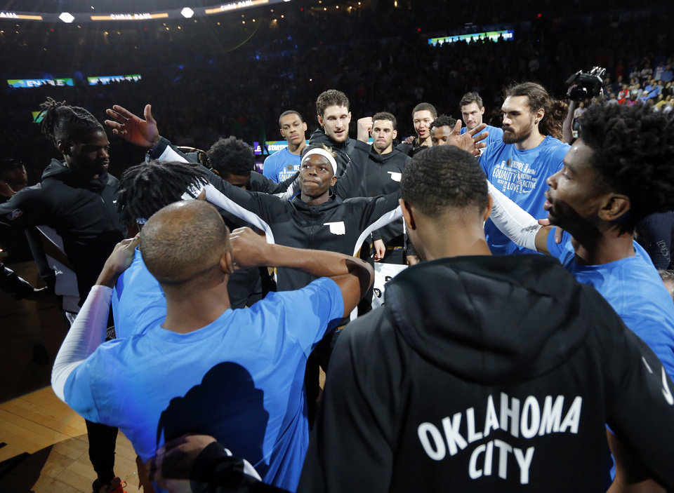 Photo - Oklahoma City's Dennis Schroder (17) raises his arms as Thunder players gather together after introductions before an NBA basketball game between the Oklahoma City Thunder and the Boston Celtics at Chesapeake Energy Arena in Oklahoma City, Sunday, Feb. 9, 2020. Boston won 112-111. [Nate Billings/The Oklahoman]