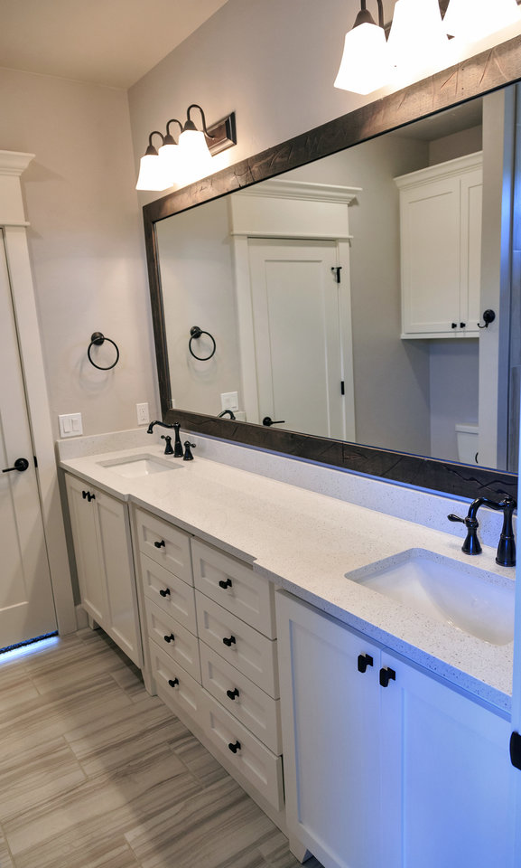Photo -  A view of the master bathroom at 8217 Ridge Creek Road in Edmond's Ridge Creek addition, built by Foster Signature Homes, also developed the neighborhood southwest of Douglas Boulevard and Coffee Creek Road. Ridge Creek is the featured neighborhood in the Parade of Homes Fall Classic. [PHOTO BY CHRIS LANDSBERGER, THE OKLAHOMAN]