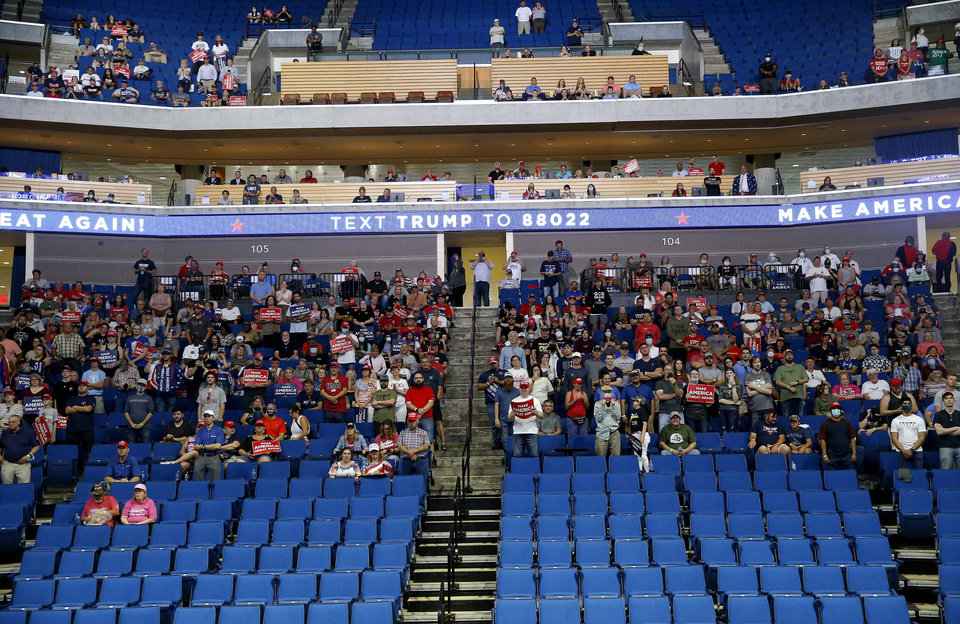 Photo - Supporters listen to President Donald Trump speaks during a rally at the BOK Center in Tulsa, Okla., Saturday, June 20, 2020. [Sarah Phipps/The Oklahoman]