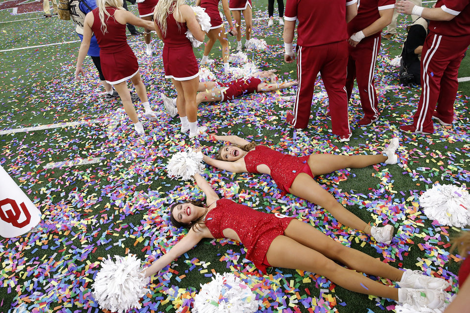 Photo - Oklahoma Pom Squad members celebrate after the Big 12 Championship Game between the University of Oklahoma Sooners (OU) and the Baylor University Bears at AT&T Stadium in Arlington, Texas, Saturday, Dec. 7, 2019. Oklahoma won 30-23. [Bryan Terry/The Oklahoman]