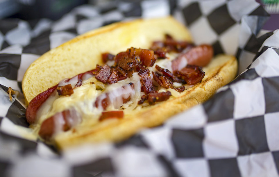 Photo - The Urb Express' 2017 Great Taste of a Fair food award winning item the Honey Bacon Pepper Dog, during the opening day of the 2017 Oklahoma State Fair in Oklahoma City, Okla. on Thursday, Sept. 14, 2017.  Photo by Chris Landsberger, The Oklahoman