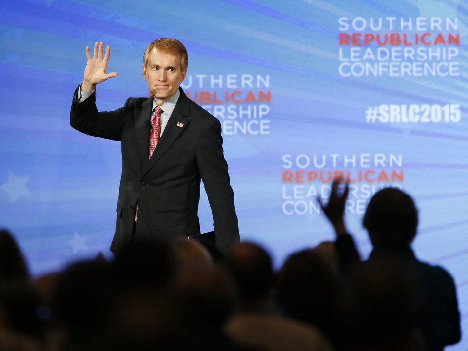 Photo - Oklahoma U.S. Sen. James Lankford waves as he leaves the stage after speaking during the final day of the Southern Republican Leadership Conference at the Cox Convention Center in Oklahoma City, Saturday, May 23, 2015. Photo by Nate Billings, The Oklahoman