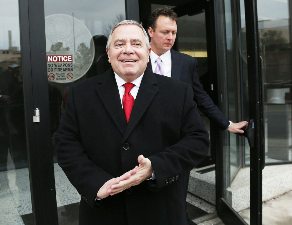Photo - Left: Former Senate leader Mike Morgan arrives Tuesday morning at the Oklahoma City federal courthouse for his sentencing in a bribery case. Above: He smiles broadly Tuesday afternoon while meeting with the media after the judge sentenced him to probation