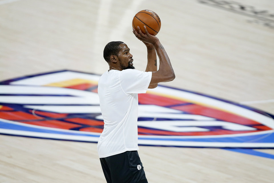 Photo - Brooklyn's Kevin Durant shoots baskets before an NBA basketball game between the Oklahoma City Thunder and the Brooklyn Nets at Chesapeake Energy Arena in Oklahoma City, Friday, Jan. 29, 2021. [Bryan Terry/The Oklahoman]