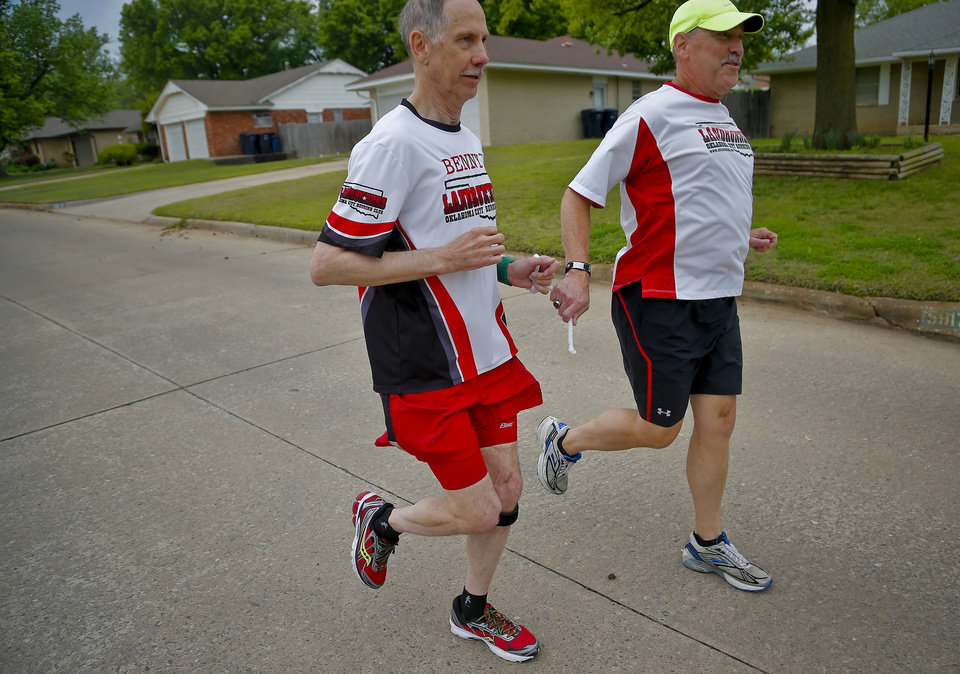 Photo - Blind runner Benny Meier, left, runs with his guide Kevin Lynes in Meier's neighborhood as they prepare for the Oklahoma City Memorial Marathon in Oklahoma City, Okla. on Friday, April 24, 2015. Meier will be competing in the half marathon in this year's event.  Photo by Chris Landsberger, The Oklahoman
