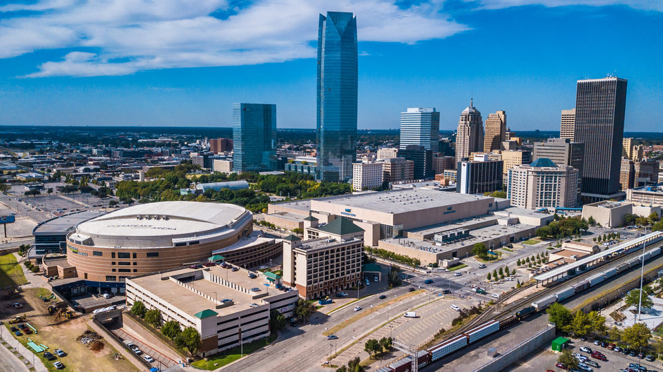 Photo - Drone image of downtown OKC, looking west along OKC Boulevard towards Scissortail Park. Image by Dave Morris.
