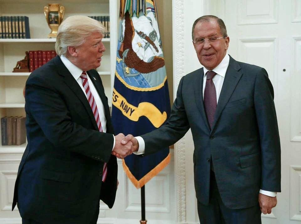 Photo - US President Donald Trump shakes hands with Russian Foreign Minister Sergey Lavrov in the White House in Washington, Wednesday, May 10, 2017. President Donald Trump on Wednesday welcomed Vladimir Putin's top diplomat to the White House for Trump's highest level face-to-face contact with a Russian government official since he took office in January. (Russian Foreign Ministry Photo via AP)
