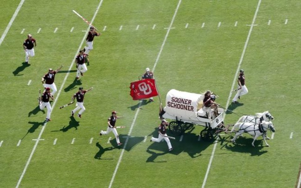 Photo -  The Sooner Schooner and RUF/NEKS run before a 2018 game. Despite  COVID-19 limiting capacity on Saturday, the Schooner will run as normal. [The Oklahoman Archives]