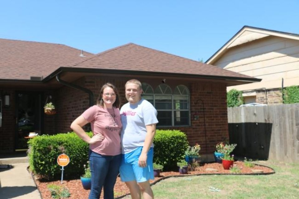 Photo -  Erin Francis and Jason Pucciarelli at their new home in south Oklahoma City. [OHFA PHOTO]