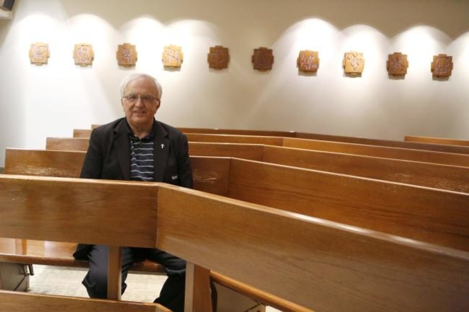 Photo -  Richard Thibodeau, manager of pastoral care at Mercy Hospital, sits in the chapel at the health care facility, 4300 W Memorial Road. [Paxson Haws/The Oklahoman]