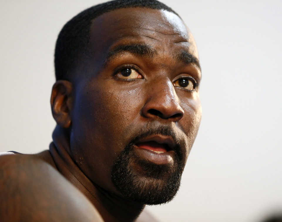 Photo - Kendrick Perkins responds to a question at a press conference during media day for the Oklahoma City Thunder NBA basketball team at the Thunder Events Center in Oklahoma City, Monday, Oct. 1, 2012.  Photo by Nate Billings, The Oklahoman