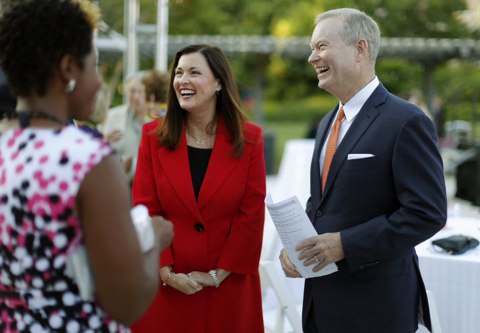 Photo - Oklahoma City Mayor Mick Cornett and his wife Terri Cornett during the OKC Welcome Reception Celebration at the Myriad Botanical Gardens during the Southern Republican Leadership Conference in downtown Oklahoma City, Thursday, May 21, 2015. Photo by Bryan Terry, The Oklahoman