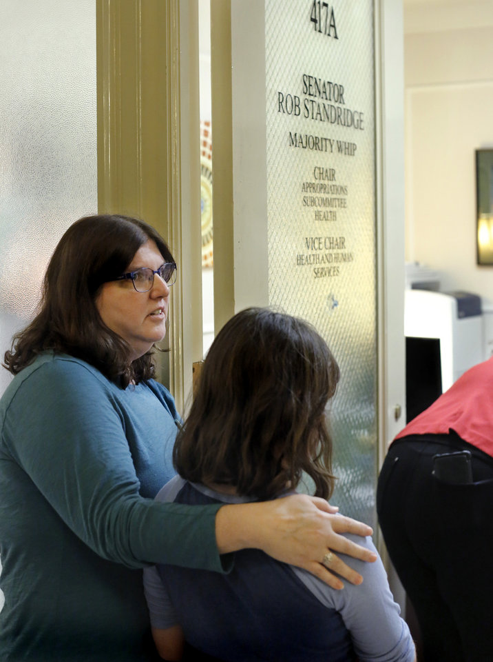 Photo - Karen Robinson and her daughter, Liberty Robinson, 9, wait outside the doorway to Sen. Rob Standridge's Capitol office after traveling from their home in Macomb to participate in the rally and voice their concerns to lawmakers. Advocates for mental health care descended upon the state Capitol Tuesday morning, Oct. 24, 2017, to demand that lawmakers come up with a budget solution that includes funding for mental health services. Photo by Jim Beckel, The Oklahoman