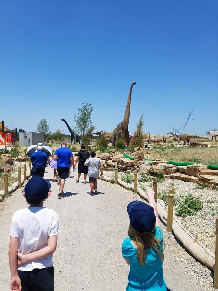Photo - Visitors enter Field Station: Dinosaurs in Derby, Kansas. [Photo by Brandy McDonnell, The Oklahoman]