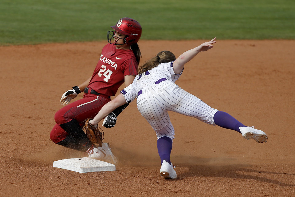 Photo - Oklahoma's Raegan Rogers (24) slides past Northwestern's Rachel Lewis (11) at second base in the fifth inning of the second softball game in the Norman Super Regional between the University of Oklahoma (OU) and Northwestern in Norman, Okla., Saturday, May 25, 2019. Oklahoma won 8-0 to send them to the Women's College World Series. [Bryan Terry/The Oklahoman]