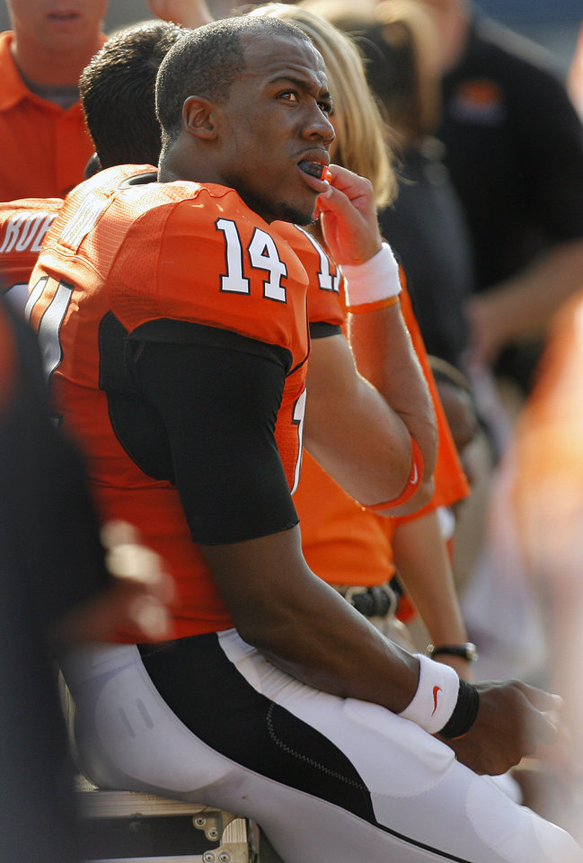 Photo - Oklahoma State's Bobby Reid sits on the sideline during the second half of the college football game between the Oklahoma State University Cowboys (OSU) and the Texas Tech University Red Raiders (TTU) at Boone Pickens Stadium in Stilllwater, Okla., on Saturday, Sept. 22, 2007. OSU won, 49-45. By NATE BILLINGS, The Oklahoman