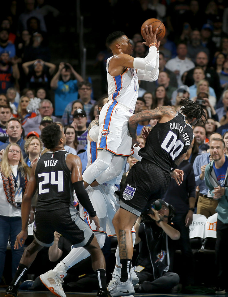 Photo - Oklahoma City's Russell Westbrook (0) is called for a foul as he runs into Sacramento's Willie Cauley-Stein (00) in the final seconds an NBA basketball game between the Oklahoma City Thunder and the Sacramento Kings at Chesapeake Energy Arena in Oklahoma City, Saturday, Feb. 23, 2019. Sacramento won 119-116. Photo by Bryan Terry, The Oklahoman