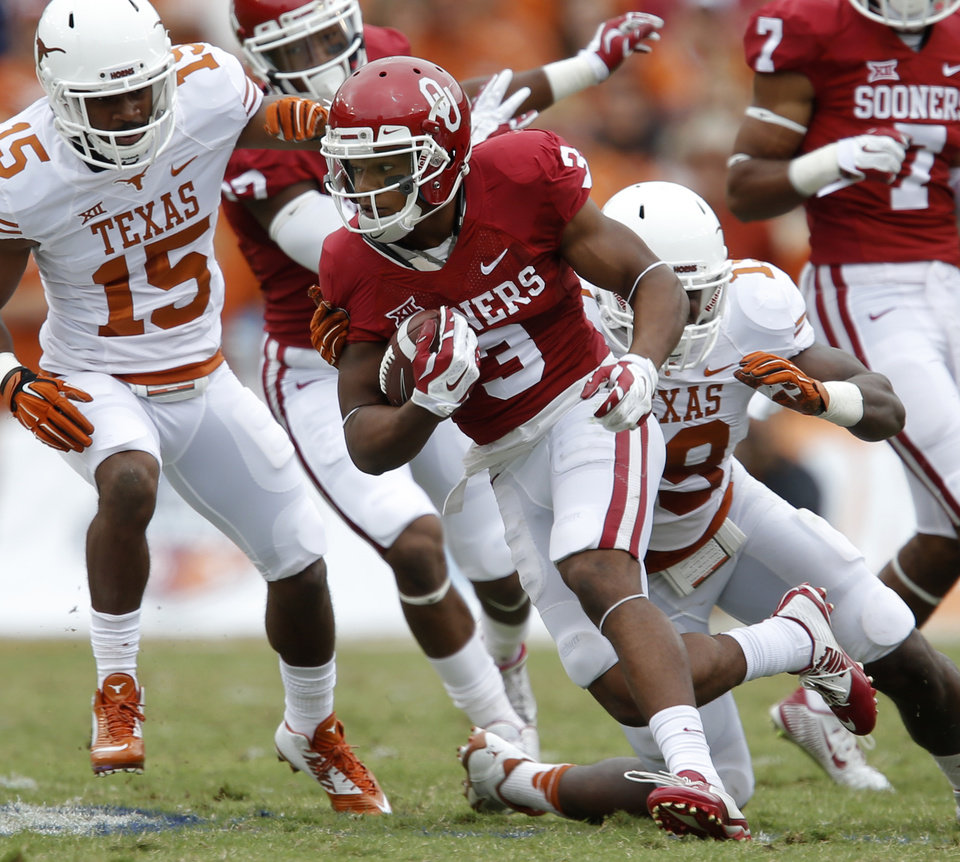 Photo - Oklahoma's Sterling Shepard (3) tries to get past Texas' Bryson Echols (15) and Texas' Peter Jinkens (19) during the Red River Showdown college football game between the University of Oklahoma Sooners (OU) and the University of Texas Longhorns (UT) at the Cotton Bowl in Dallas on Saturday, Oct. 11, 2014. 